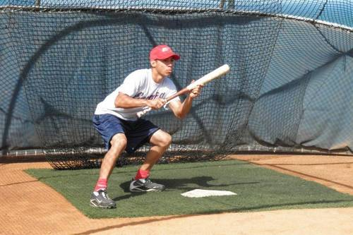 Manu Febles working on his bunting